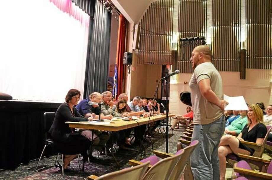 John Daudelin was one of the fourteen residents to voice displeasure over the program. Ryan Flynn - Register Citizen