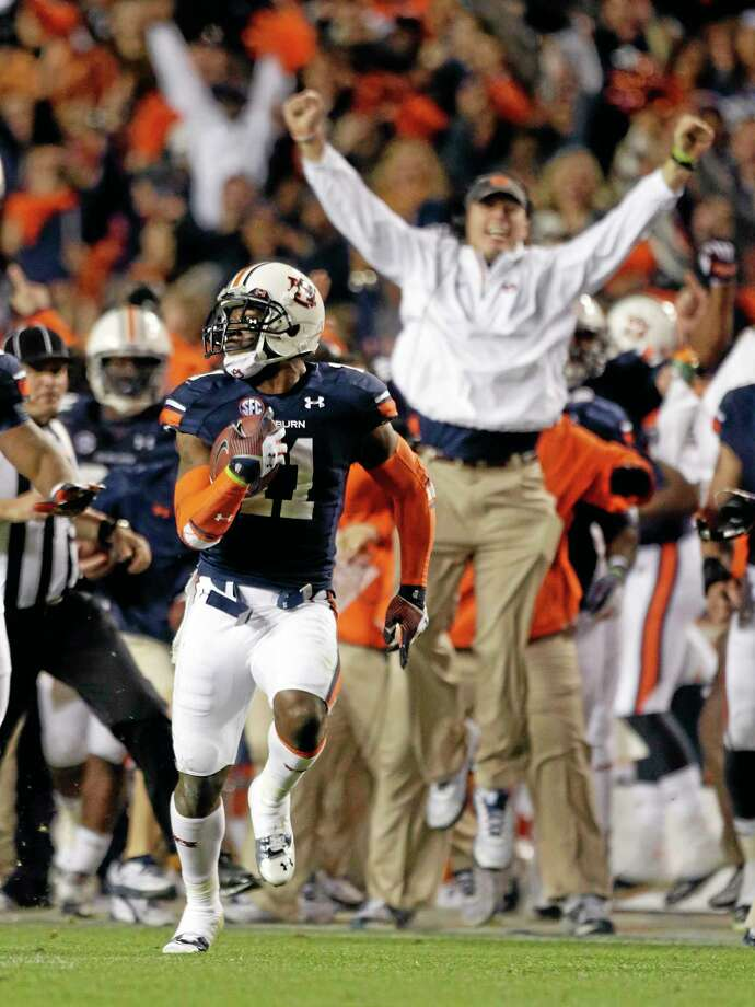 Auburn cornerback Chris Davis (11) returns a missed field goal attempt 100-plus yards to score the game-winning touchdown against Alabama Saturday. Photo: Dave Martin — The Associated Press  / AP