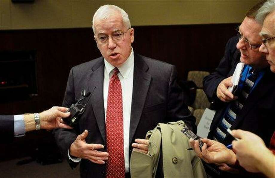 John Egelhof, a former FBI agent who was the scene commander and case agent at the 2005 mass shooting at Red Lake High School, speaks with reporters after a hearing on proposed new gun laws with the House public safety committee in the State Office Building in St. Paul, Minn. on Wednesday, Feb.  6, 2013.  Hundreds of people from both sides of the debate swarmed the Capitol office building for the hearing, jamming the committee room and several overflow areas a day after President Barack Obama visited Minneapolis to tout his federal gun-control proposals.  With Democrats controlling the Legislature, new limits on gun access have their best shot at the Capitol in a number of years. But the debate could expose divides between urban Democrats, who represent areas where new gun limits are popular, and rural Democrats from areas with high gun ownership and less support for serious curtailments on the ability to own weapons.  (AP Photo/The St. Paul Pioneer Press, Ben Garvin)  MINNEAPOLIS STAR TRIBUNE OUT Photo: AP / The St. Paul Pioneer Press