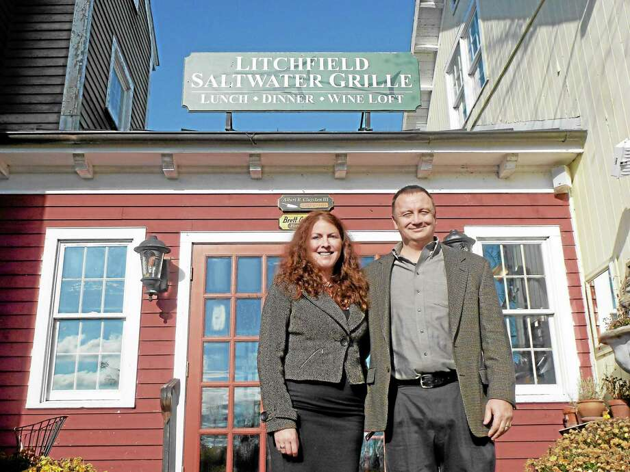 Brook Noel and Andy Stowers, both from Wisconsin, have purchased the Litchfield Saltwater Grille from previous owners Brett and Albert Clugston. Photo: Ryan Flynn — Register Citizen