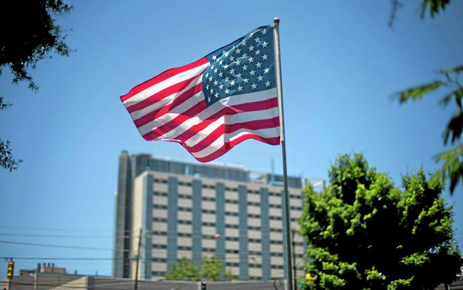 FILE - In this May 24, 2013 file photo, an American flag flies in front of the Atlanta VA Medical Center in Atlanta. The FBI revealed on Wednesday, June 11, 2014, that it had opened a criminal investigation into a Department of Veterans Affairs reeling from allegations of falsified records and inappropriate scheduling practices. (AP Photo/David Goldman, File) Photo: AP / AP