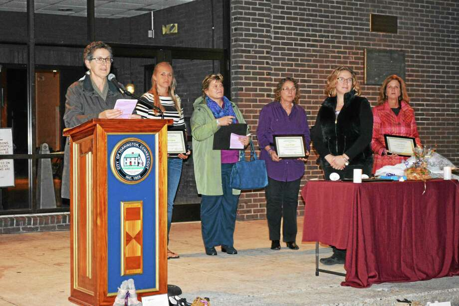 Barbara Spiegel, executive director the Susan B. Anthony Project, handed out plaques to honor several local educators for their work in the community during a vigil at Coe Memorial Park in Torrington. Photo: Ryan Flynn — The Register Citizen