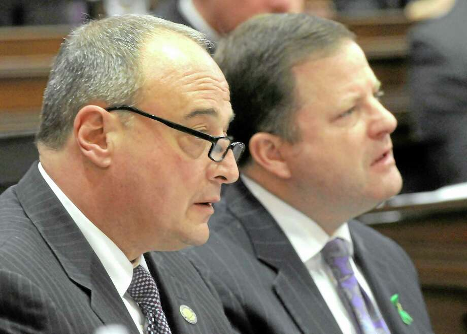 House Minority Leader Lawrence Cafero, R-Norwalk, left, and Senate Minority Leader, John McKinney, R-Fairfield listen to Gov. Dannel P. Malloy address the CT legislature in his biennial budget address. Mara Lavitt/New Haven Register ¬  ¬ 2/6/13 Photo: Journal Register Co.