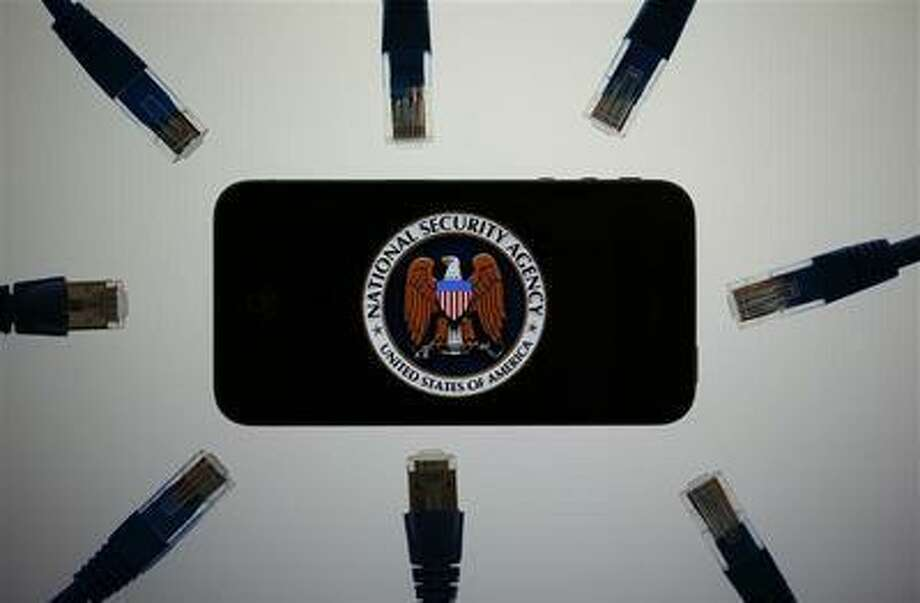 An illustration shows the logo of the U.S. National Security Agency on the display of an iPhone in Berlin, June 7, 2013. Photo: REUTERS / X00616