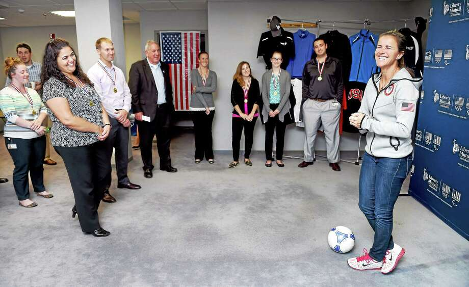 Former U.S. Olympic soccer player Brandi Chastain, right, meets with insurance claims management employees of Liberty Mutual Insurance in their Wallingford office on Wednesday. Photo: Arnold Gold — Register