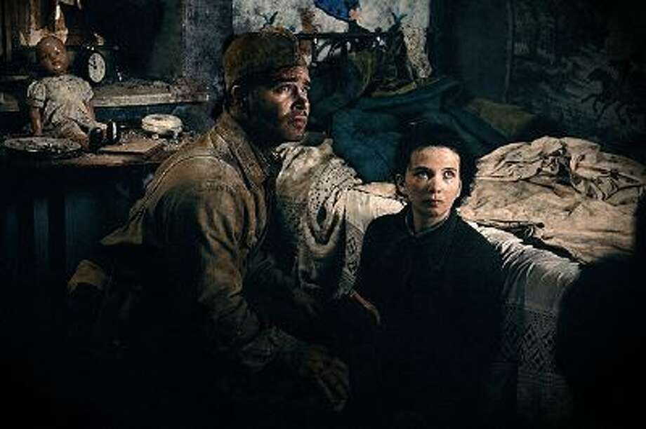 """This image released by Sony Pictures shows Philippe Reinhardt, left, and Mariya Smolnikova in a scene from """"Stalingrad."""" (AP Photo/Sony Pictures) Photo: AP / Sony Pictures"""