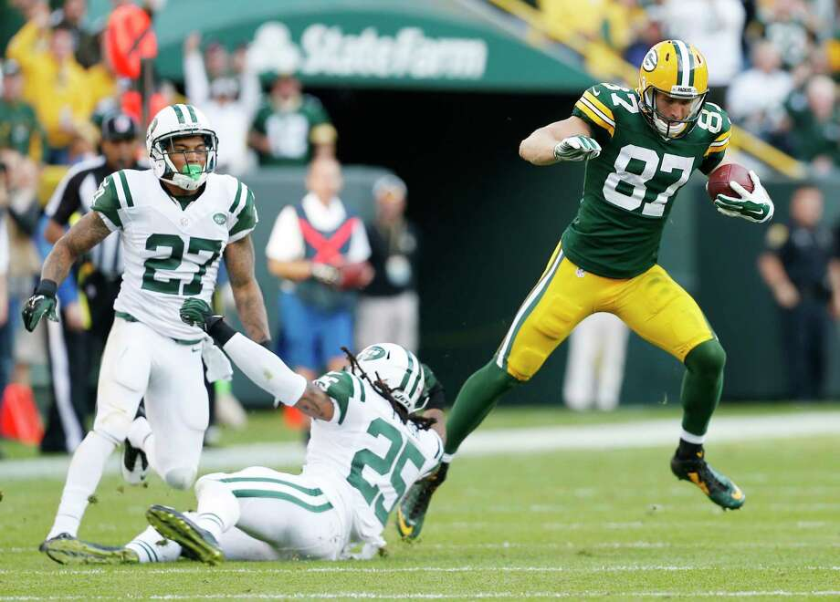 Green Bay Packers receiver Jordy Nelson gets away from New York Jets defensive backs Calvin Pryor (25) and Dee Milliner for an 80-yard touchdown catch during a Sept. 14 game in Green Bay, Wis. Photo: Mike Roemer — The Associated Press File Photo  / FR155603 AP