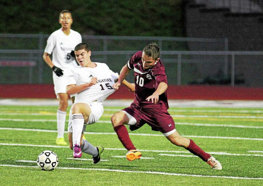 Naugatuck's Michael Campos and Torrington's Amar Suljic battle for control of the ball. Photo: Marianne Killackey — Special To The Register Citizen  / 2014
