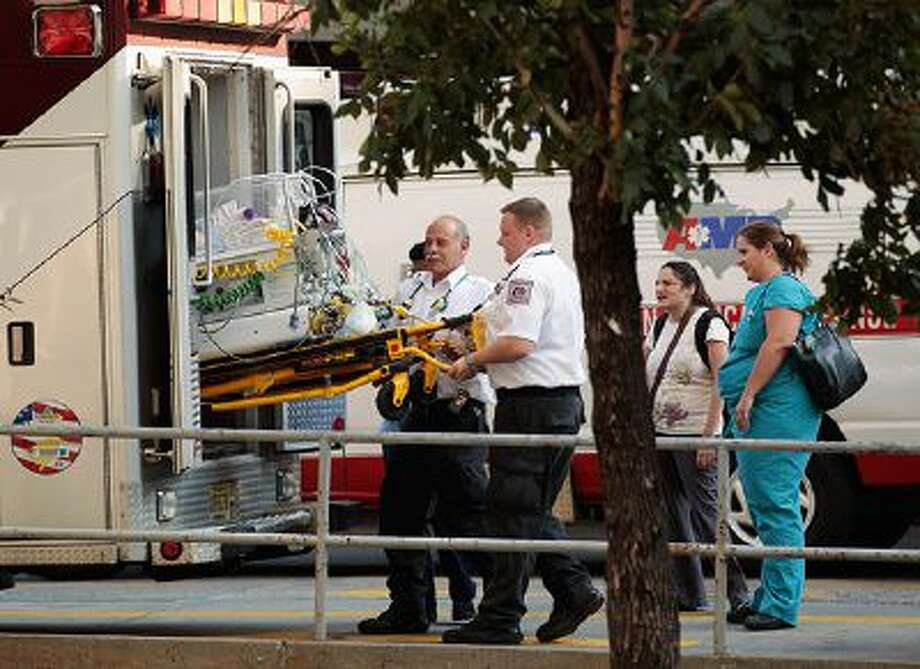 NEW YORK, NY - AUGUST 26: Paramedics and EMTs load an incubator holding a baby into an ambulance after NYU Langone Medical Center was ordered to evacuate about 400 patients August 26, 2011 in New York City. The hospital began evacuating patients Friday afternoon in accordance with a direct order from the NYC Office of Emergency Management and the NYS Department of Health in anticipation of Hurricane Irene.  (Photo by Chip Somodevilla/Getty Images) Photo: Getty Images / 2011 Getty Images