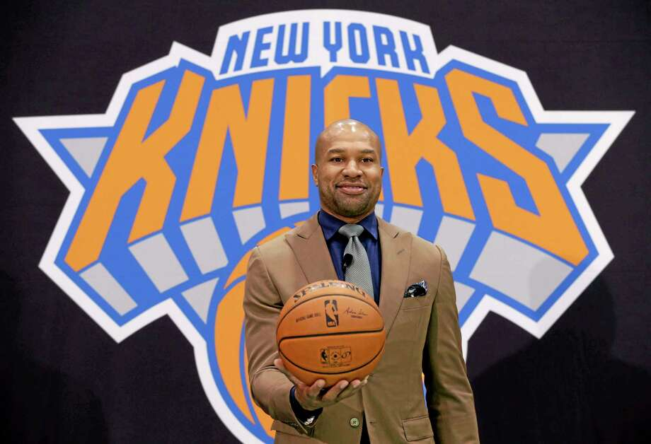 Derek Fisher poses for a picture during a news conference Tuesday in Tarrytown, New York. The New York Knicks hired Fisher as their new coach with team president Phil Jackson turning to one of his trustiest former players. Photo: Seth Wenig — The Associated Press  / AP