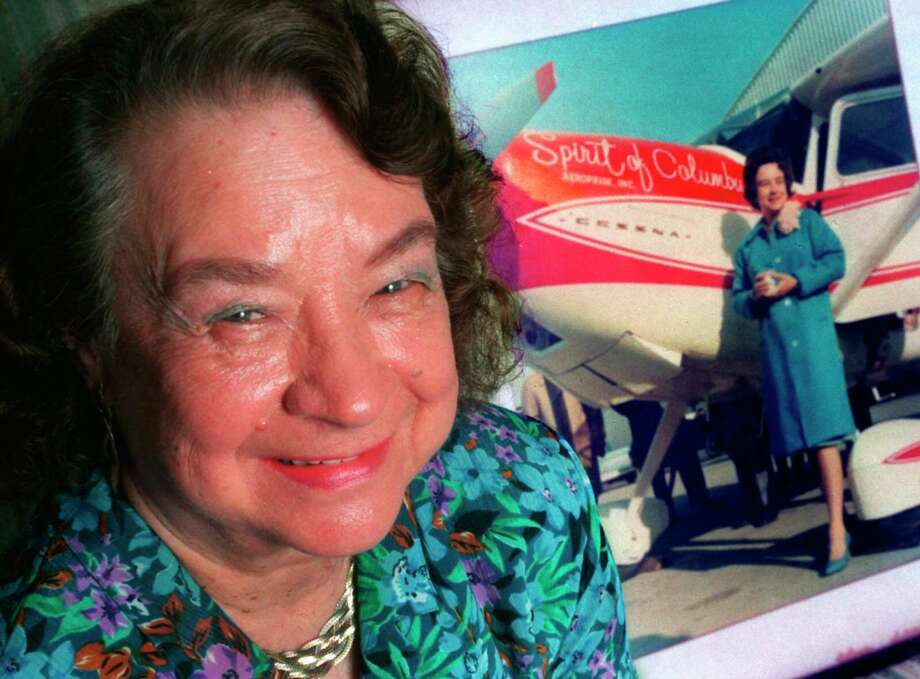 """FILE - In this March 25, 1994, file photo, Geraldine """"Jerrie"""" Mock poses, in Quincy, Fla., next to a photograph of her that was taken minutes before her historic around-the-world flight in 1964. Mock, who 50 years ago became the first female pilot to fly solo around the globe, died Tuesday, Sept. 30, 2014, at her home in Florida. She was 88. (AP Photo/Tallahasee Democrat, Mike Ewen, File) Photo: AP / Tallahasee Democrat"""