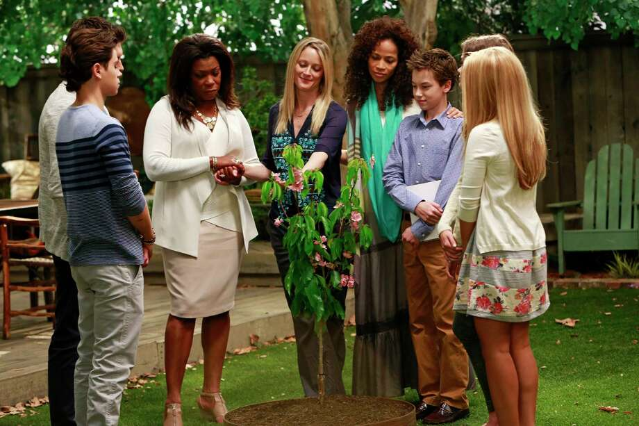 """This photo released by ABC Family shows, from left, Jake T. Austin, Lorraine Toussaint, Teri Polo, Sherri Saum, Hayden Byerly, and Maia Mitchell, in a scene from """"The Fosters,"""" on ABC Family. The media advocacy group GLAAD on Wednesday, Oct. 1, 2014, released its annual report on diversity on TV, including depictions of gay characters. (AP Photo/ABCFamily, Ron Tom) Photo: AP / ABC Family"""