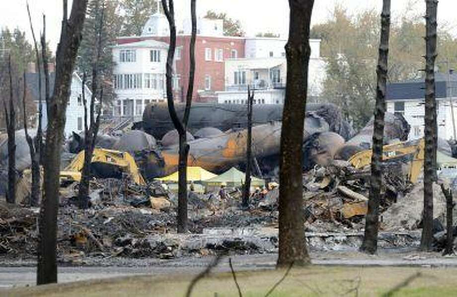 An emergency worker stands on the site of the train wreck in Lac Megantic, July 16, 2013. Photo: REUTERS / X80003