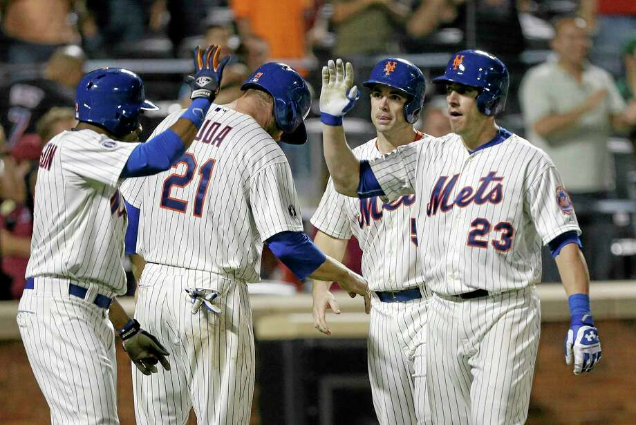 New York Mets catcher Taylor Teagarden (23) celebrates with David Wright (5), Lucas Duda (21) and Curtis Granderson after hitting a grand slam during the sixth inning of a 6-2 win over the Milwaukee Brewers on Tuesday at Citi Field. Photo: Frank Franklin II — The Associated Press  / AP