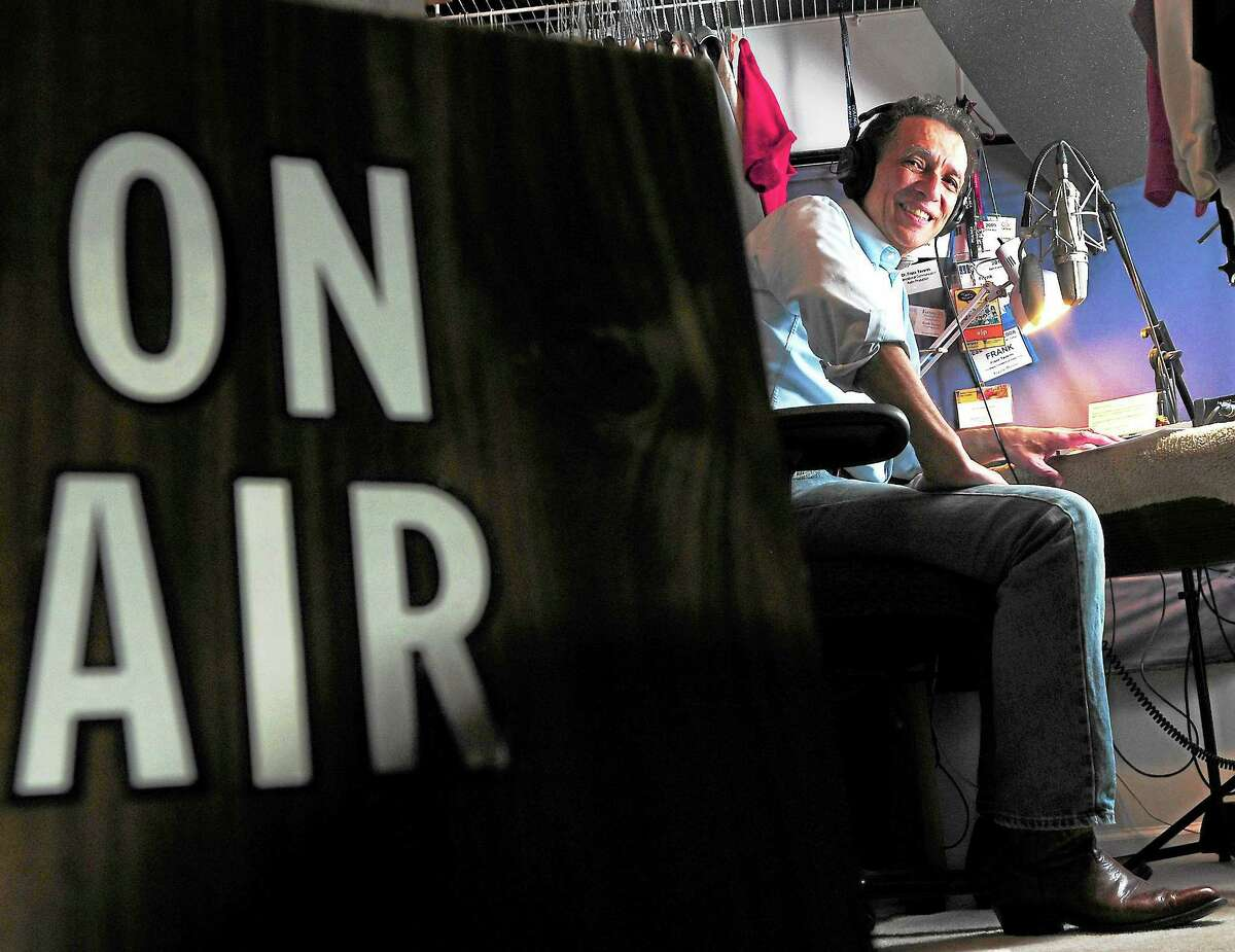 Frank Tavares, a recently retired National Public Radio announcer, in his longtime makeshift radio studio in the closet of his Hamden home.