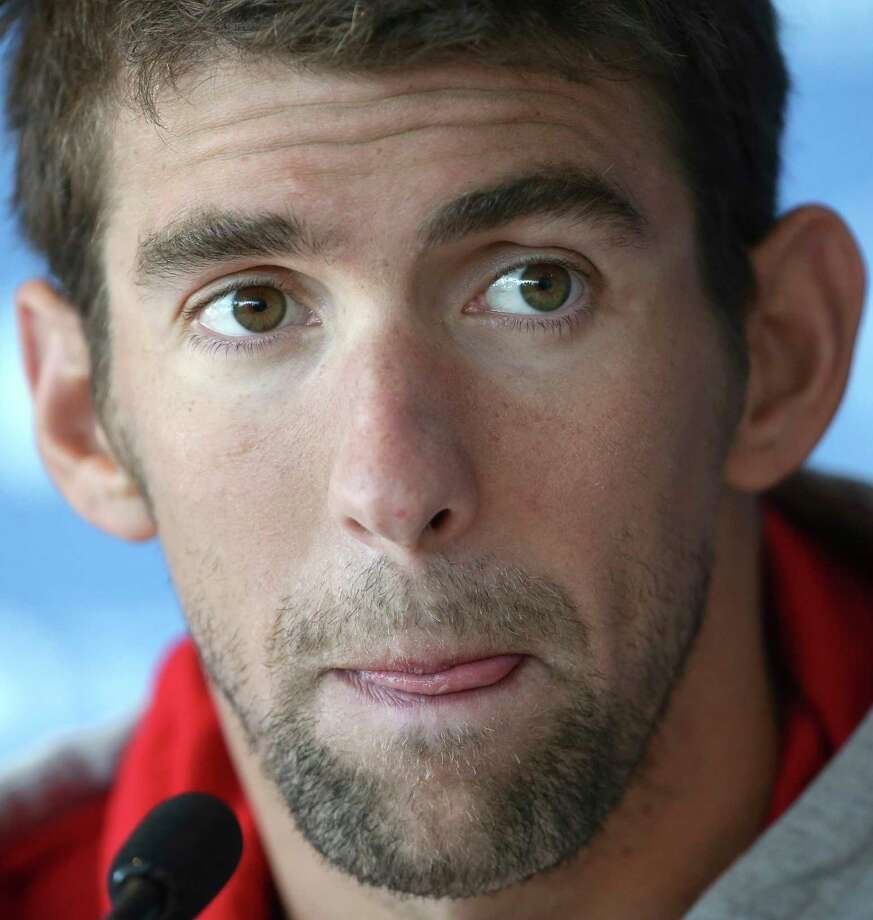 In this file photo, swimmer Michael Phelps speaks during an August press conference in Australia. Phelps was arrested Thursday and faces DUI charges. Photo: (AP Photo/Rick Rycroft, File) / AP