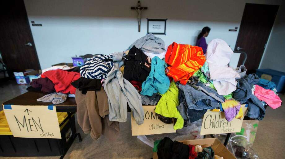 Clothing is piled up in a Red Cross shelter at the Sacred Heart Church for victims