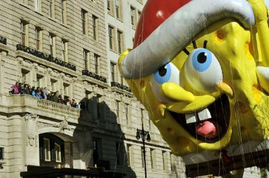SpongeBob Squarepants makes his way down Central Park West during the 87th Macy's Thanksgiving Day Parade in New York on November 28, 2013. Photo: AFP/Getty Images / 2013 AFP