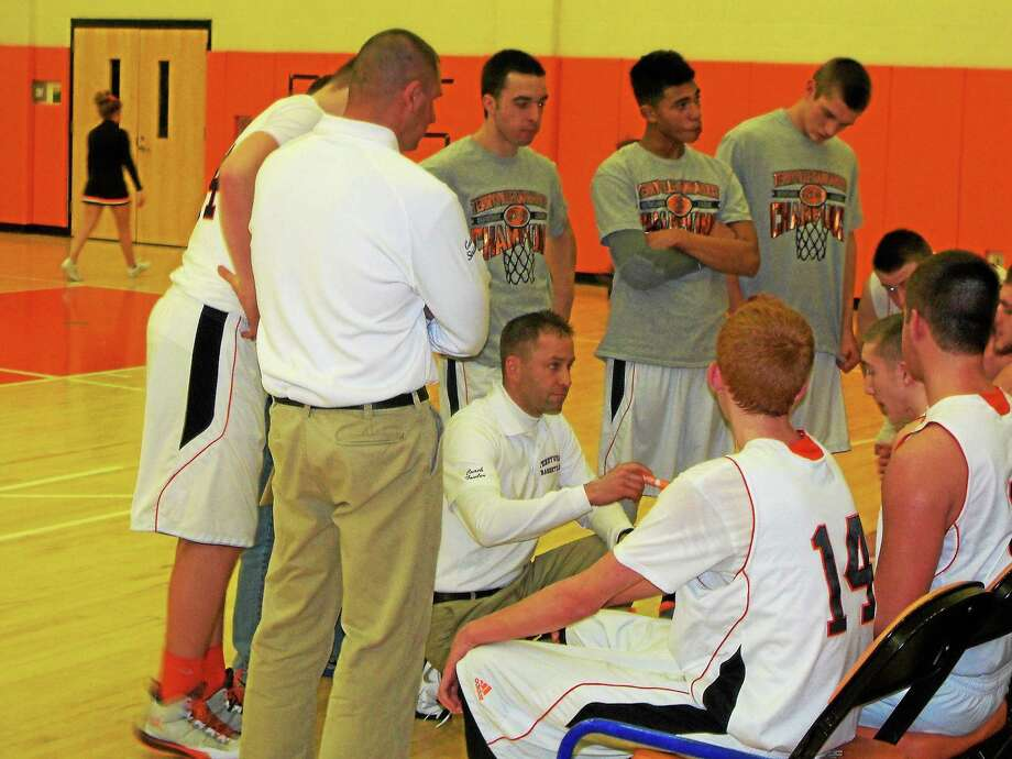 Terryville head coach Mark Fowler talks to his team during a time out against Nonnewaug. The Kanagaroo's won 79-50. Photo: Peter Wallace — Register Citizen
