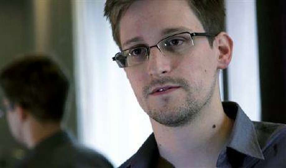 This photo provided by The Guardian Newspaper in London shows Edward Snowden, who worked as a contract employee at the National Security Agency, on Sunday, June 9, 2013, in Hong Kong. The Guardian identified Snowden as a source for its reports on intelligence programs after he asked the newspaper to do so on Sunday. (AP Photo/The Guardian) Photo: AP / The Guardian
