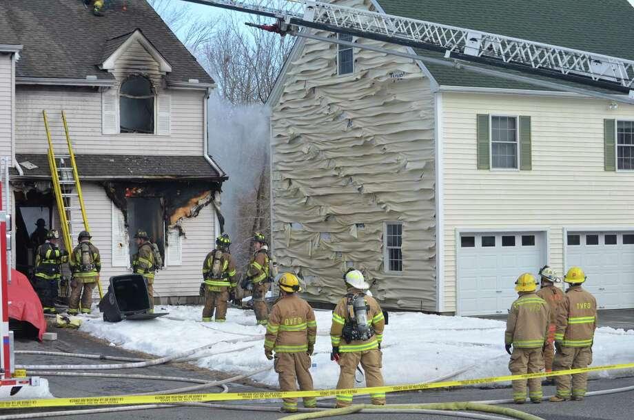 Firefighters battle a blaze on Griswold Street in Torrington. Tom Cleary/Register Citizen.