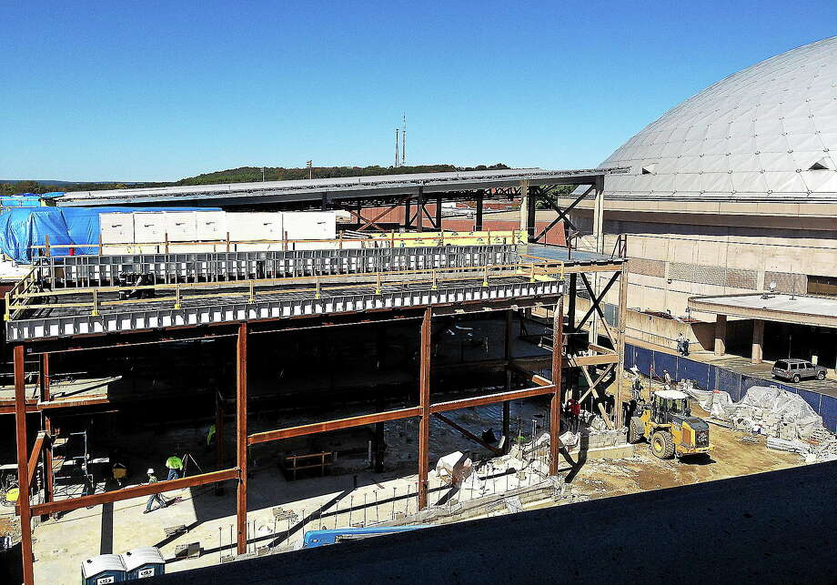 In this Sept. 24, 2013 file photo, workers continue building UConn's new basketball training facility adjacent to Gampel Pavilion in Storrs. Photo: Pat Eaton-Robb — The Associated Press  / AP