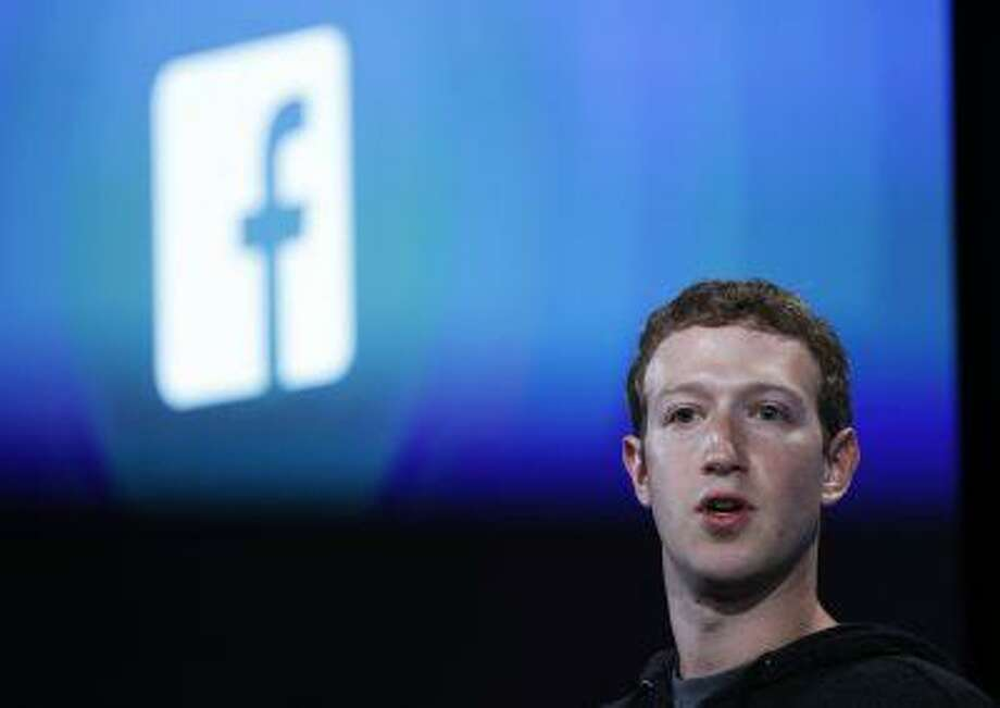 Mark Zuckerberg, Facebook's co-founder and chief executive introduces 'Home' a Facebook app suite that integrates with Android during a Facebook press event in Menlo Park, California, April 4, 2013. Photo: REUTERS / X90034