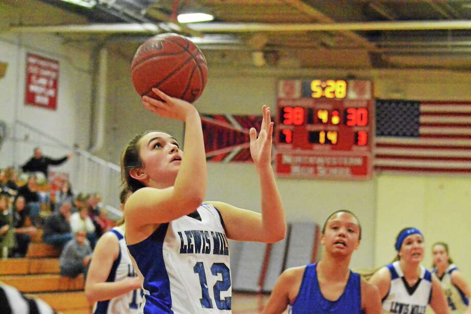 Lewis Mills' Natalie Ruel lays in two of her 13 points to help lead the Spartans to the BL Tournament finals on Friday night. Photo: Pete Paguaga — Register Citizen