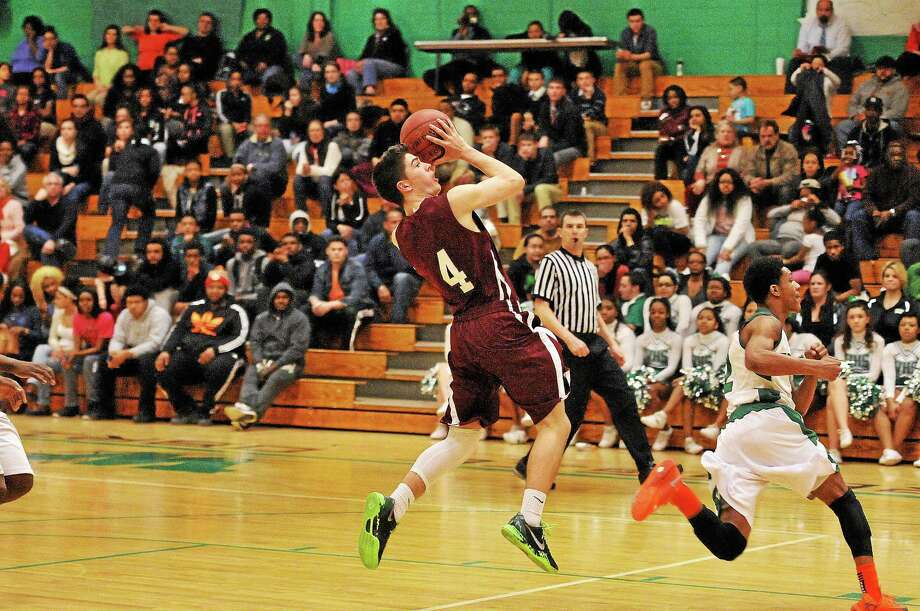 Torrington's John McCarthy shoots during the Red Raiders 68-65 win over Wilby. Photo: Laurie Gaboardi — Register Citizen