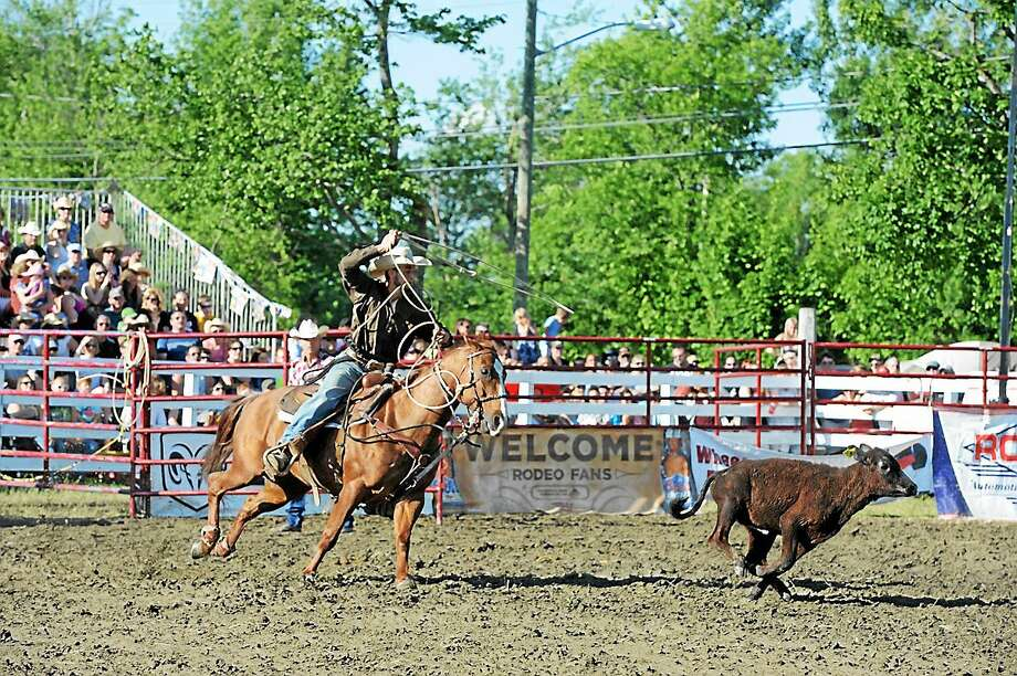 A rodeo performer chases a calf Saturday at the 2013 Goshen Stampede, held at the Goshen Fairgrounds. Photo: Register Citizen File Photo