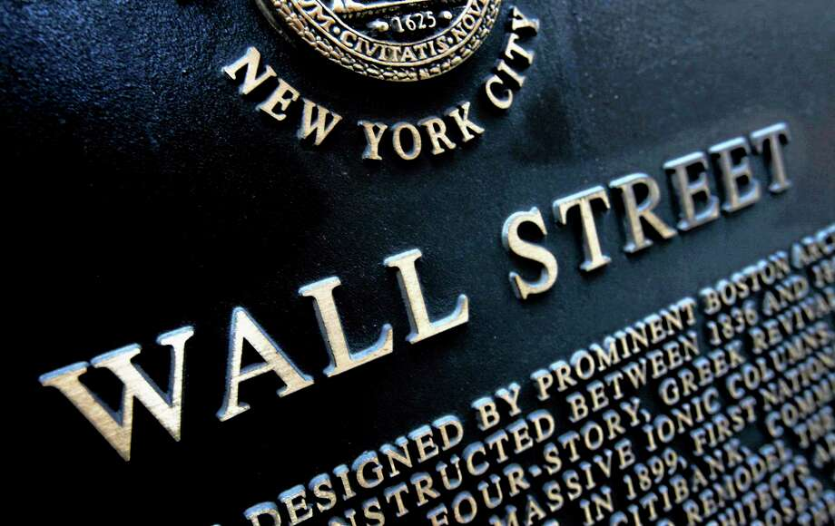 FILE - This Jan. 4, 2010 file photo shows an historic marker on Wall Street in New York. The stock market drifted lower Tuesday, June 10, 2014, after major indexes reached another record high the day before. (AP Photo/Mark Lennihan, File) Photo: AP / AP