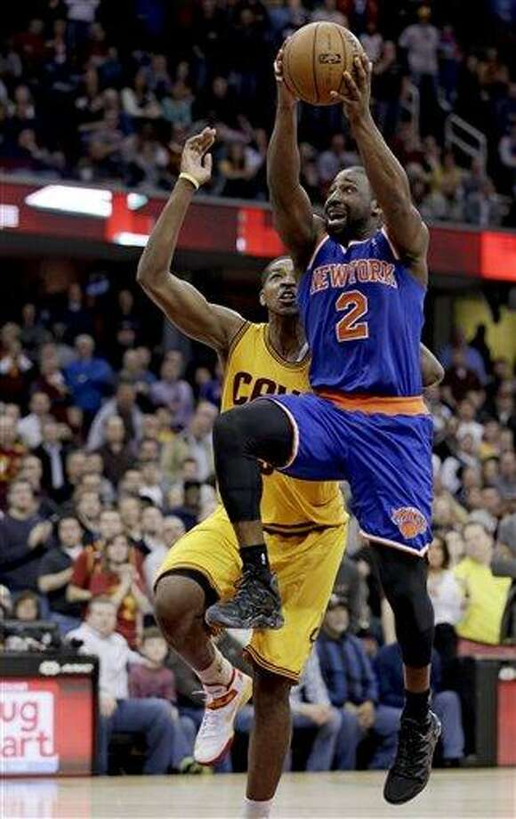 New York Knicks' Raymond Felton (2) jumps to the basket against Cleveland Cavaliers' Tristan Thompson (13) during the fourth quarter of an NBA basketball game, Monday, March 4, 2013, in Cleveland. The Knicks won 102-97. (AP Photo/Tony Dejak) Photo: ASSOCIATED PRESS / AP2013