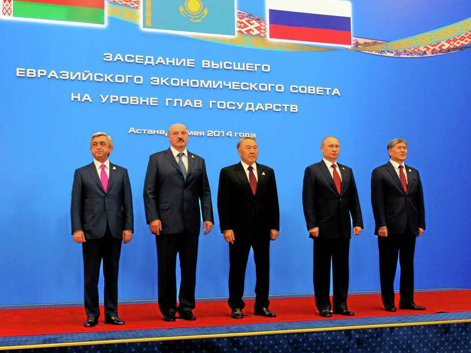 Posing for a photo during a meeting of the Eurasian Economic Council, with from left, Armenian President Serge Sarkisian, Belarusian President Alexander Lukashenko, Kazakh President Nursultan Nazarbayev,  Russian President Vladimir Putin, and Kyrgyz President Almazbek Atambayev,  in Astana, Kazakhstan, Thursday, May 29, 2014.  The leaders of Russia, Belarus and Kazakhstan on Thursday created an economic union that intends to boost cooperation between the ex-Soviet neighbors, a pact which was at the source of the crisis in Ukraine. (AP Photo/RIA-Novosti, Mikhail Klimentyev, Presidential Press Service) Photo: AP / RIA Novosti Kremlin
