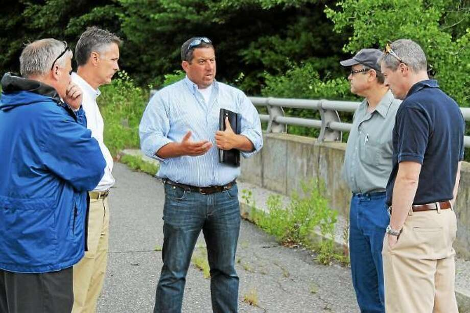 State Rep. Jay Case (Center) met with Dale Martin, Neil Amwake and DEEP Officials to find a solution to the crumbling infrastructure of town dams. - Contributed photo