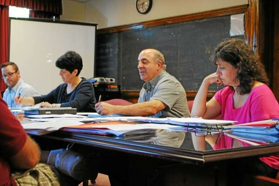 Board of Education policy committee members look at a possible update to the board's field trip policy. The new policy could cut red tape for field trip planners. Jessica Glenza - Register Citizen