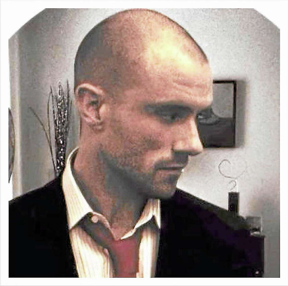 This profile photo on the Ryan Cochran Escort Service website matches the profile photograph on a LinkedIn account purporting to be Samuel See's. Photo: Journal Register Co.