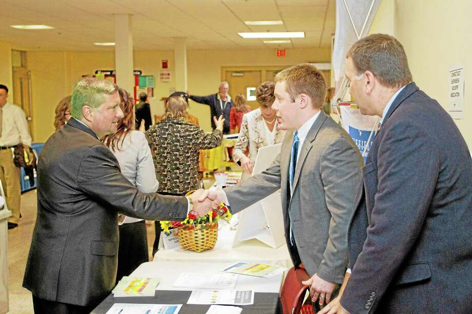 State Sen. John A. Kissel, left, greets Connecticut Business and Industry Association Assistant Counsel Eric Gjede, center, and CBIA Membership Director Joe Dias, right, during a previous Step Up conference held at Asnuntuck Community College in Enfield. Photo: Submitted FIle Photo.   / All Rights Reserved