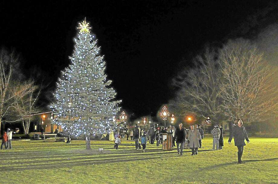 """The tree at Coe Memorial Park in Torrington was lit Friday night as part of the city's annual """"Light up Main"""" event. Photo: Photos By Laurie Gaboardi — Register Citizen"""
