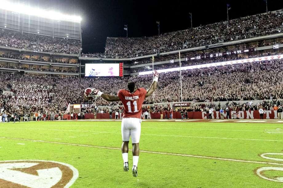 Alabama linebacker Shaun Dion Hamilton (11) celebrates after the Crimson Tide's win over Auburn on Saturday. Photo: The Associated Press  / AL.com