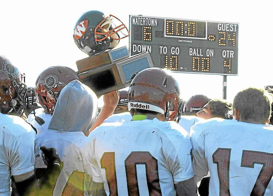 For the second year in a row the Torrington Red Raiders won the Battle of the Helmet defeating Watertown, 24-6. Photo: Laurie Gaboardi — Register Citizen