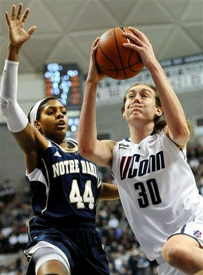 Connecticut's Breanna Stewart (30) drives to the basket while guarded by Notre Dame's Ariel Braker during the second half of an NCAA college basketball game in Storrs, Conn., Saturday, Jan. 5, 2013. Notre Dame won 73-72. (AP Photo/Jessica Hill) Photo: ASSOCIATED PRESS / A2013