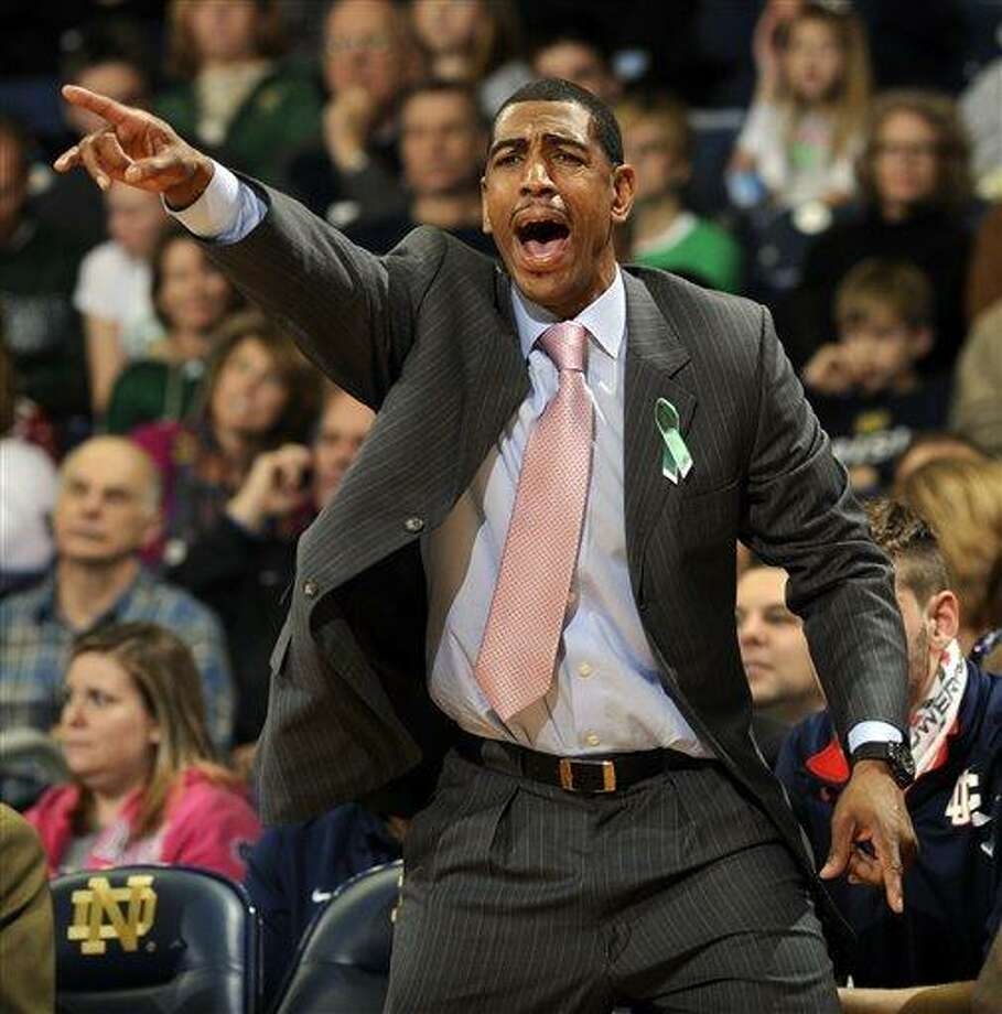 Connecticut coach Kevin Ollie shouts instructions to his team during the first half of an NCAA college basketball game against Notre Dame, Saturday, Jan. 12, 2013, in South Bend, Ind. (AP Photo/Joe Raymond) Photo: ASSOCIATED PRESS / Joe R. Raymond2013