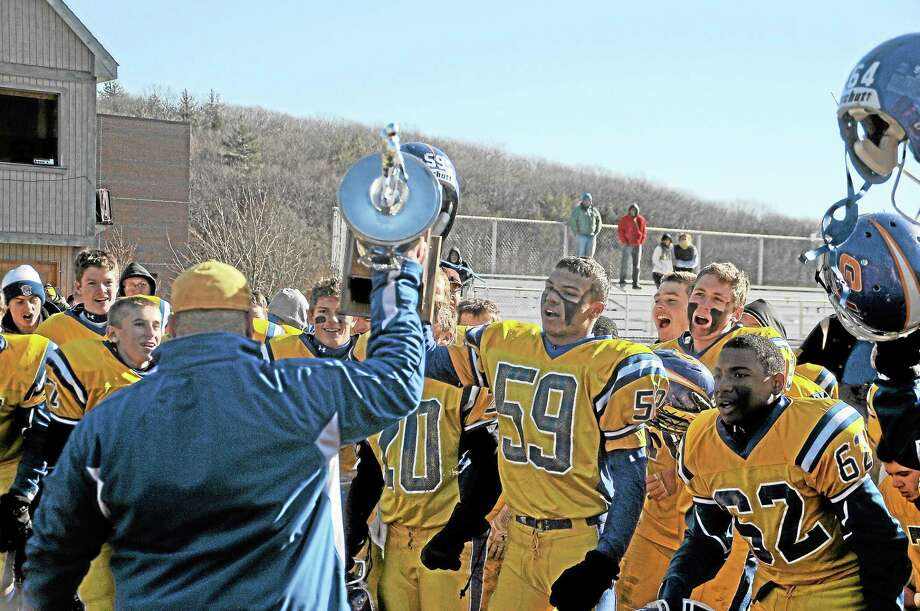 Gilbert/Northwestern head coach Scott Salius celebrates with his team holding the Berkshire Bowl trophy following the Yellowjacket's victory against Housatonic/Wamogo. Photo: Sean Meenaghan — Register Citizen