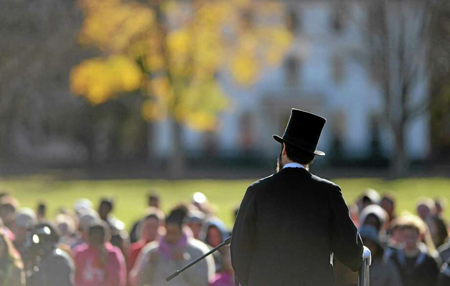 Abraham Lincoln re-enactor Howard Wright recites the Gettysburg Address to students from Norwich Free Academy gathered on Chelsea Parade in Norwich, Conn., to mark the 150th anniversary of the speech Tuesday, Nov. 19, 2013.  (AP Photo/The Day, Sean D. Elliot)    MANDATORY CREDIT Photo: AP / THE DAY