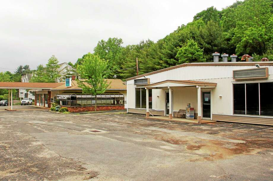 The small plaza on 281 Winsted Rd. on Tuesday, June 10, 2014, in Torrington. A developer wants to demolish the two parcels and build a 9,000 square-foot retail shop. Esteban L. Hernandez Register Citizen Photo: Journal Register Co.