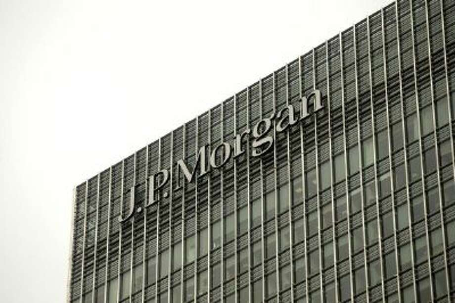 A logo sits on display outside the offices of JPMorgan Chase & Co. in the Canary Wharf business and shopping district in London, U.K., on Tuesday, Sept. 17, 2013. Two former JPMorgan Chase & Co. traders were indicted for engaging in a securities fraud to hide trading losses that eventually surpassed $6.2 billion on wrong-way derivatives bets last year. Photographer: Matthew Lloyd/Bloomberg via Getty Images Photo: Bloomberg Via Getty Images / 2013 Bloomberg