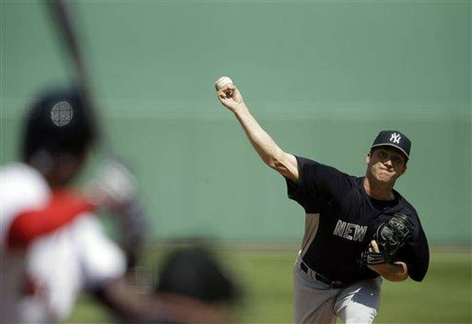 New York Yankees starting pitcher Adam Warren throws to Boston Red Sox's Dustin Pedroia in the first inning of an exhibition spring training baseball game on Sunday, March 3, 2013, in Fort Myers, Fla. (AP Photo/David Goldman) Photo: ASSOCIATED PRESS / AP2013