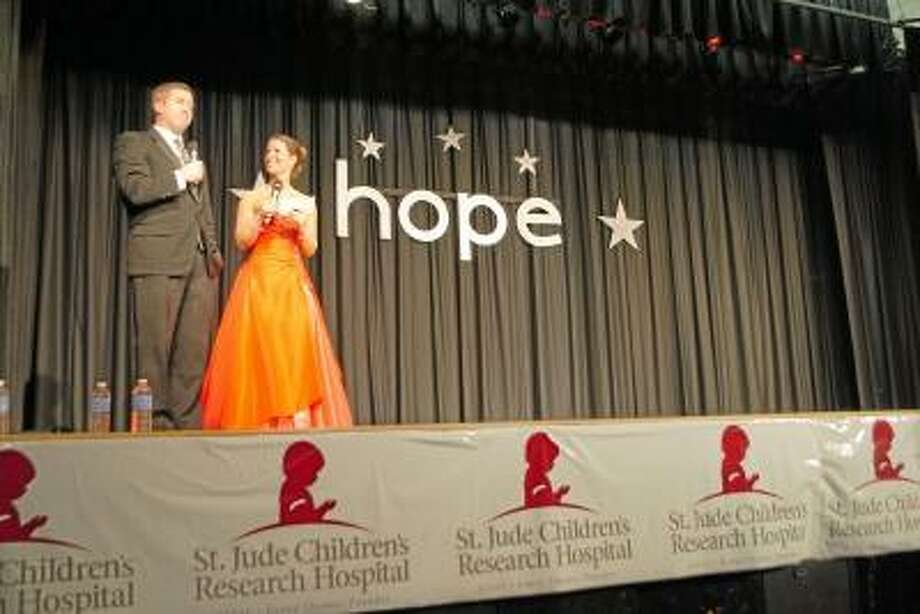 Tim Driscoll Jr. stands with his sister, Kristin Raymond at the St. Jude Children?s Hospital Telethon, at Torrington High School, Sunday. Jessica Glenza/Register Citizen