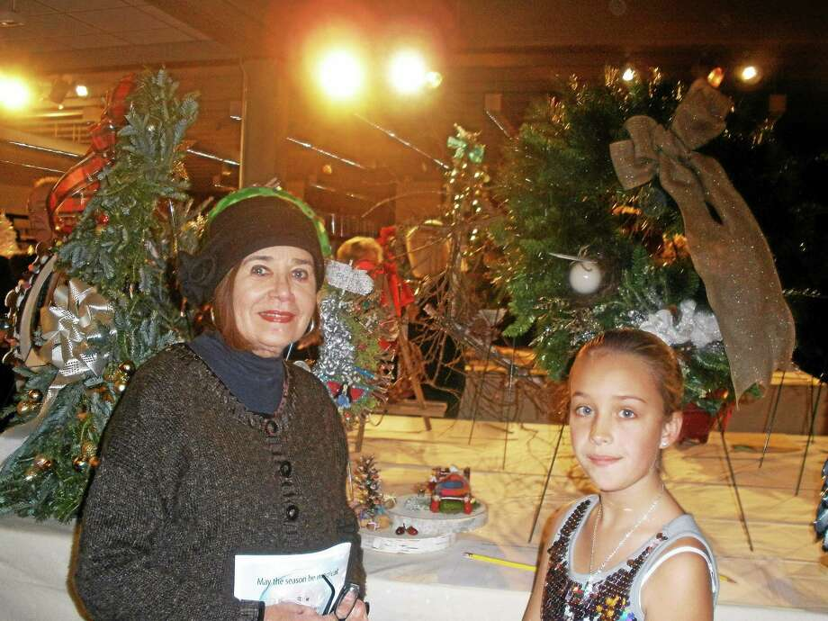 Oliver Wolcott Library held its annual Festival of Trees Gala on Saturday. The event is the library's largest fundraiser of the year. Laura Sweetman at the event with her granddaughter. Photo: Stephen Underwood — Special To The Register Citizen