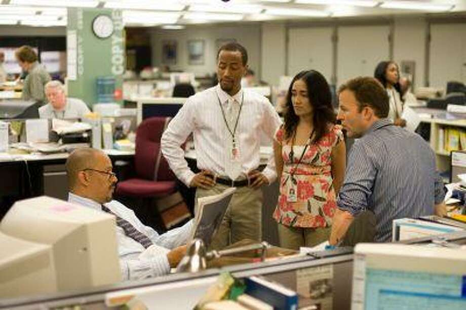 """In this photo released by HBO, (from left) actors Clark Johnson, Brandon Young, Michelle Paress, and Tom McCarthy in a scene from the upcoming season of """"The Wire"""". For its fifth and final season, which begins Jan. 6, """"The Wire"""" ventures into the newsroom of The Sun, Baltimore's newspaper of record, where executive producer and lead writer David Simon worked for 13 years as a police reporter before he took a buyout in 1995.(AP Photo/Paul Schiraldi,HBO) Photo: ASSOCIATED PRESS / AP2007"""
